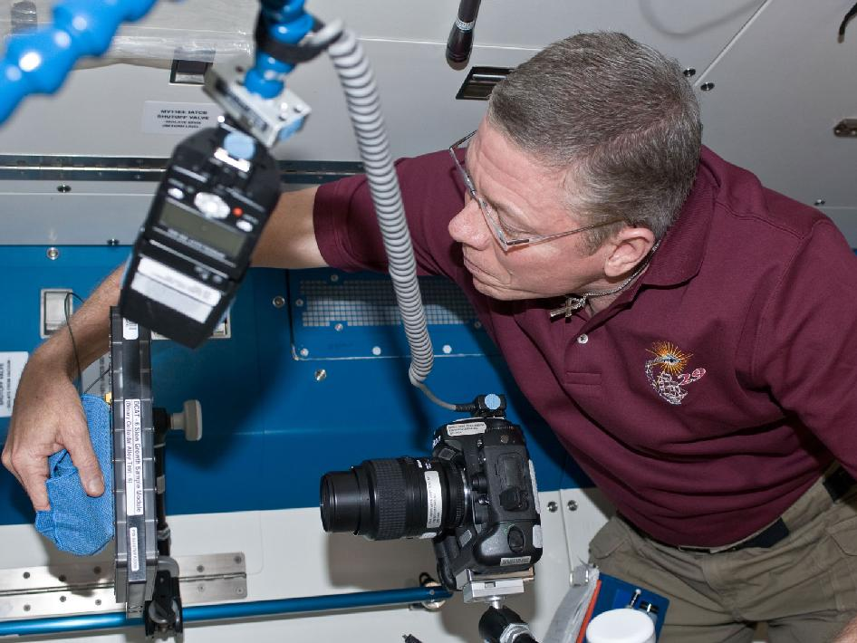 Expedition 29 Mike Fossum Conducting a Test