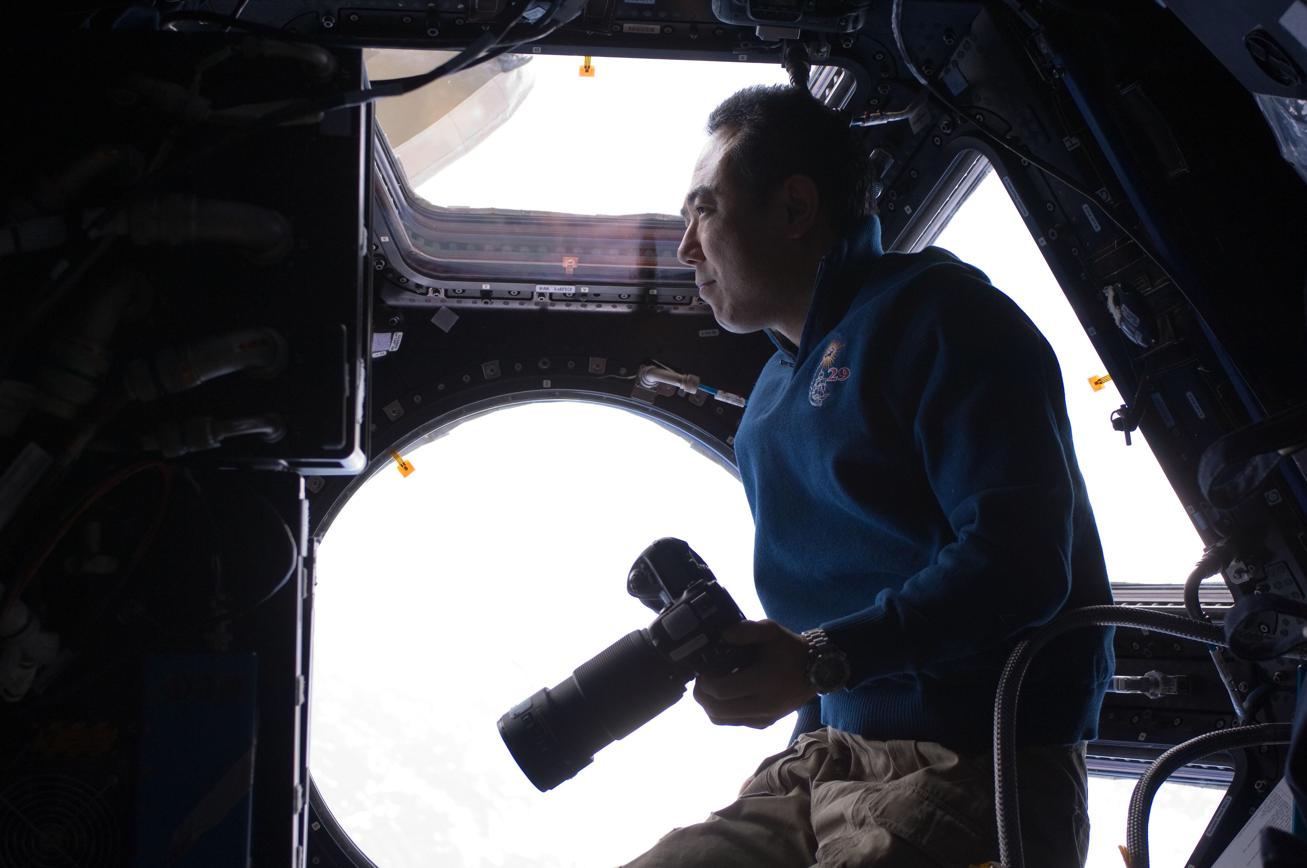 Satoshi Furukawa Holds a Still Camera in the ISS Cupola