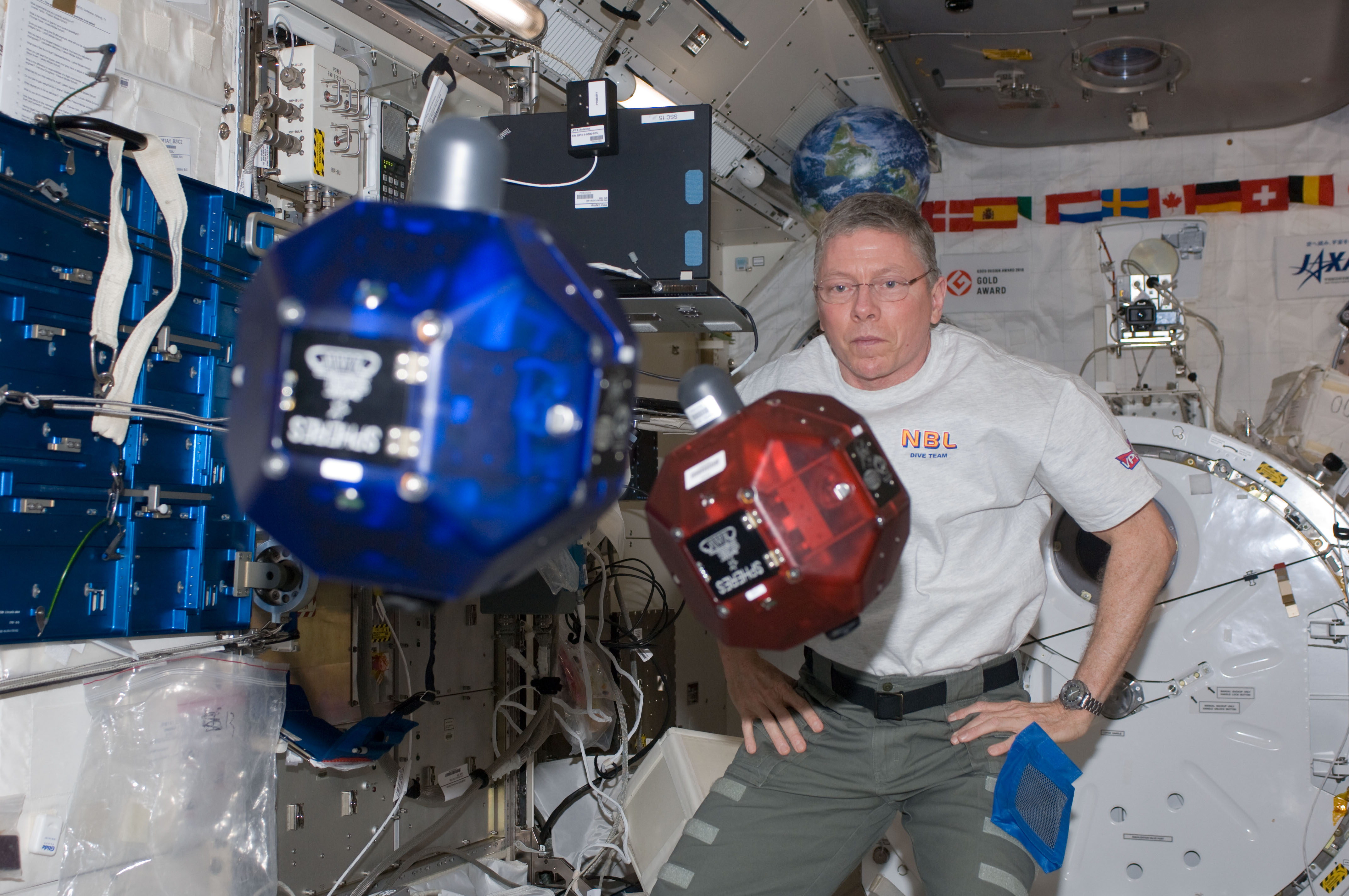 Mike Fossum with Floating SPHERES