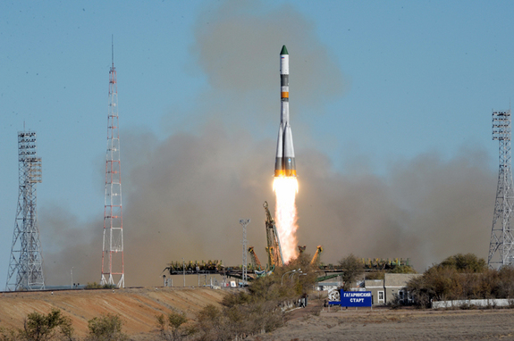A Soyuz rocket carrying the Progress 45 cargo ship lifts off from a pad at Baikonur Cosmodrome in Kazakhstan on Oct. 30, 2011.