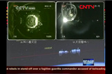 Chinese TV shows the Tiangong 1 module docking with the Shenzhou 8 spacecraft Nov. 2, 2011.