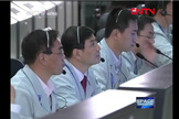 Chinese Mission Controllers watch as the Tiangong 1 spacecraft makes the country's first docking maneuver with Shenzhou 8.