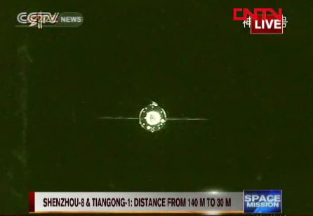 A view of China's Tiangong 1 space lab module taken by the approaching Shenzhou 8 spacecraft, just minutes before the two vessels docked in Earth orbit.