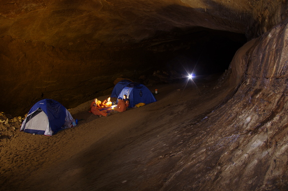 Five astronauts that took part in the European Space Agency's CAVES 2011 mission gather at their campsite for daily debriefings.