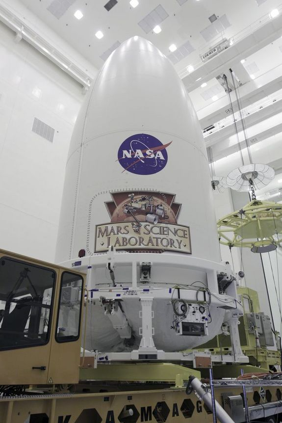 In the Payload Hazardous Servicing Facility at NASA's Kennedy Space Center in Florida, the Atlas 5 rocket's payload fairing containing NASA's Mars rover Curiosity stands securely atop the transporter that will carry it to Space Launch Complex 41 on Nov. 3, 2011.
