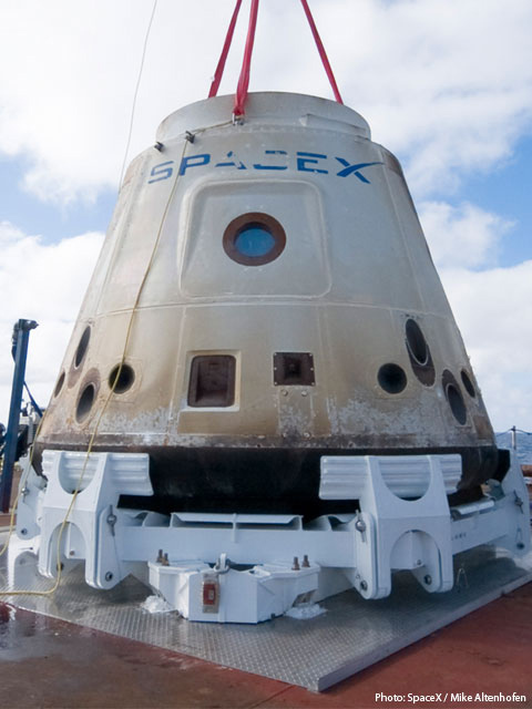 Photo of actual Dragon spacecraft after its first successful orbital flight.