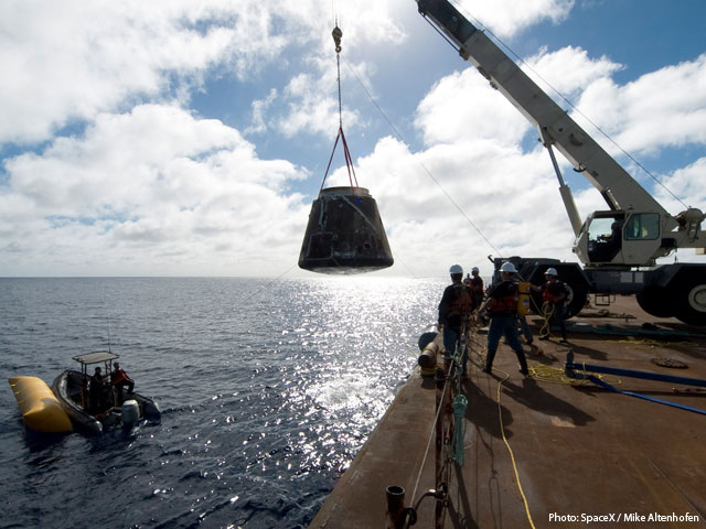 Dragon Capsule Lifted onto Barge