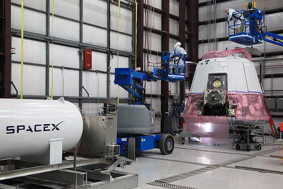 COTS 2 Demo Dragon undergoing launch prep at SpaceX hangar in Cape Canaveral.