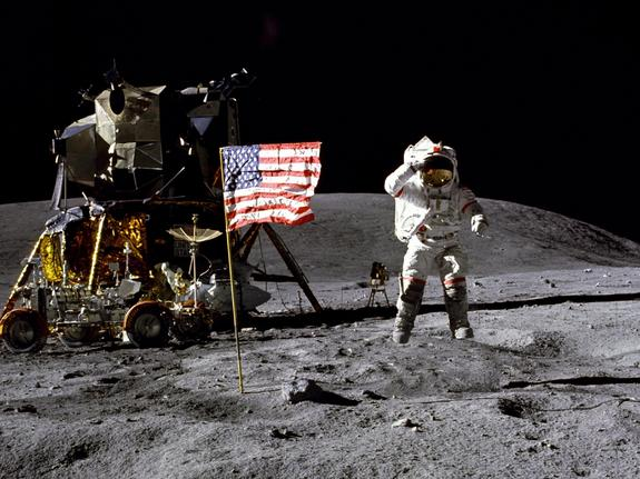 John Young, astronaut and Navy veteran, salutes the U.S. flag at the Descartes landing site during the first Apollo 16 extravehicular activity (EVA-1). Young, commander of the Apollo 16 lunar landing mission, jumps up from the lunar surface as astronaut and Air Force veteran, Charles M. Duke Jr., lunar module pilot, took this picture.