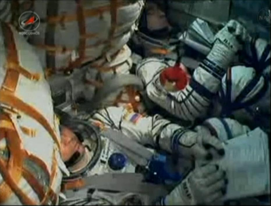 Expedition 29 Crew Inside Soyuz TMA-22 Capsule