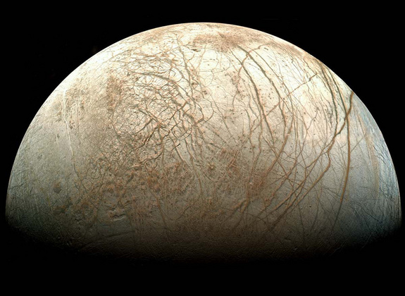 Europa, as viewed from NASA's Galileo spacecraft. Visible are plains of bright ice, cracks that run to the horizon, and dark patches that likely contain both ice and dirt.