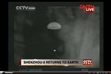 This screenshot of a CNTV Chinese news broadcast shows an infrared view of the unmanned Shenzhou 8 spacecraft as it descends to Earth under its parachute on Nov. 17, 2011. The spacecraft landed in inner Mongolia to end China's first space docking mission.