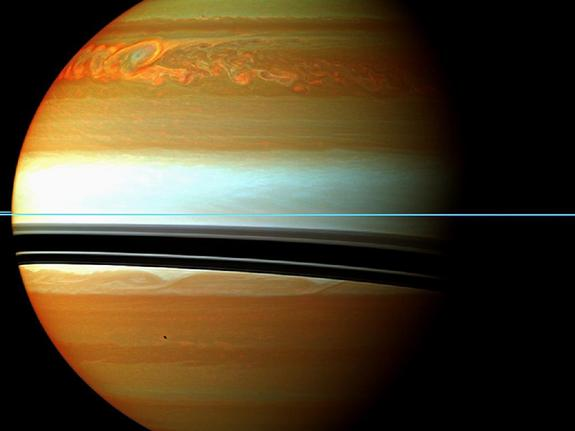 These red, orange and green clouds (false color) in Saturn's northern hemisphere indicate the tail end of a massive storm that started in December 2010. Even after visible signs of the storm started to fade, infrared measurements continued to reveal powerful effects at work in Saturn's stratosphere.