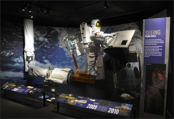 The Hubble Space Telescope, which was designed to be upgraded while in space, has features like handrails that make it possible for astronauts to perform maintenance. The diorama here re-creates a crucial moment in 2009, when astronaut John Grunsfeld installed the new Wide Field Camera 3, the device that currently captures many of Hubble's most amazing images.