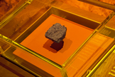 This piece of hardened lava came from Mars. After being knocked off the Martian surface by an asteroid or comet, it drifted in space for millions of years, until it reached Earth and fell to the ground as a meteorite.