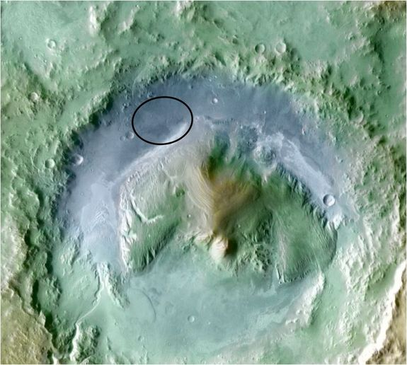 Color coding in this image of Gale Crater on Mars represents differences in elevation, with blue relatively low and tan relatively high. The vertical difference from a low point inside the landing ellipse for NASA's Mars Science Laboratory to a high point on the mountain inside the crater is about 3 miles (5 kilometers).