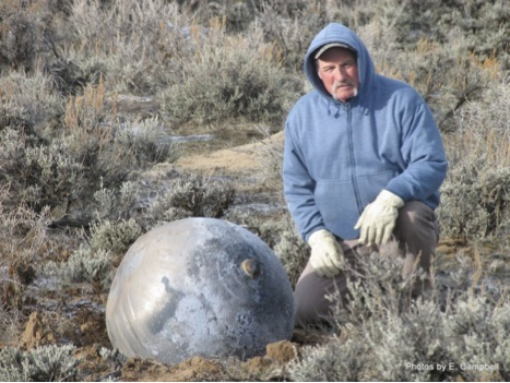"In March 2011, Robert Dunn was hiking in Moffat County, near the NW corner of Colorado. He heard a high-pitched sound that he could not identify, but it caught his attention since he was in a fairly isolated area. A short time later, he noticed a 30"" diameter object on the ground within a crater about a foot deep. There was Russian writing on the object. The object was warm when he touched it, even though he was in an area with snow on the ground. It was later identified as a spherical titanium tank originating from a Russian upper stage rocket, launched earlier that year. A followup search found another, smaller sphere 34 miles to the North-East."