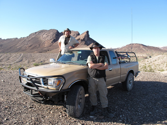 """The stars of """"Meteorite Men,"""" Steve Arnold (left) and Geoff Notkin (right) are pictured with their truck, affectionately called """"The Mule."""""""