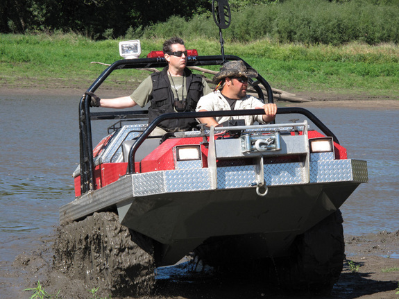 """""""Meteorite Men"""" Geoff Notkin and Steve Arnold navigate around in an amphibious vehicle. The guys affectionately call their go-anywhere Hydratrek """"The  Rockhound,"""" and it really does go anywhere."""