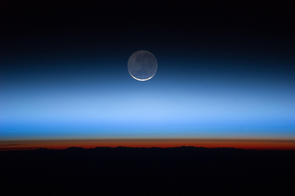 Astronauts aboard the International Space Station took this image showing Earth's atmosphere and moon on July 31, 2011.