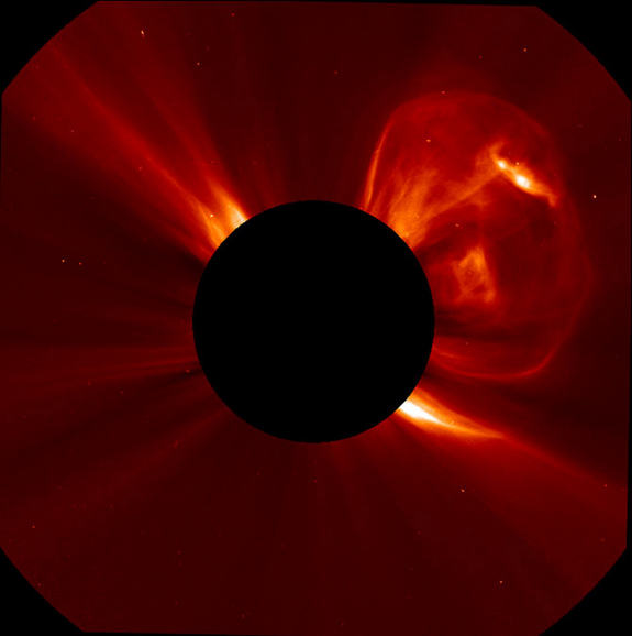A coronal mass ejection (CME) bursting off the left side of the sun. This image was captured by the SOlar and Heliospheric Observatory (SOHO) at 6:05 PM ET on September 21, 2011.