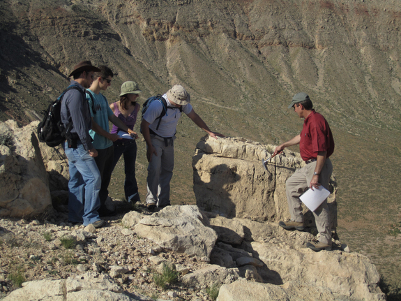 "Meteor Crater serves as a ""teachable moment"" in geological time. Shown here are graduate students taking part in a 2011 field training program at the crater. Students are introduced to impact cratering processes. Skills developed during field camp are designed to prepare students for their own thesis studies in impact cratered terrains, be it on the Earth, the Moon, Mars, or some other solar system planetary surface."