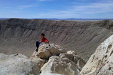 Meteor Crater in Arizona (formally called Barringer meteorite crater) viewed from the rim near the visitor center. The crater is nearly a mile across and the hole more than 550 feet deep.
