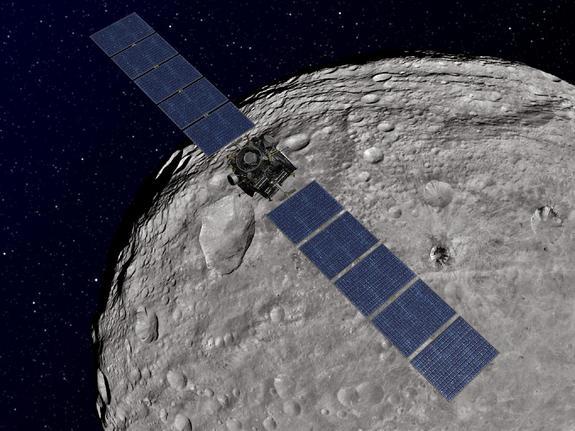 An artist's impression of the Dawn spacecraft in orbit around Vesta.