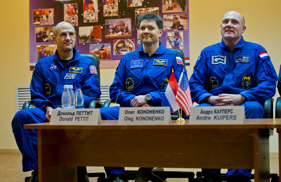 Expedition 30 crew members, from left, Don Pettit of NASA, Oleg Kononenko of Russia, and Andre Kuipers of the Netherlands speak at a press conference in Russia on Tuesday (Dec. 20), just a day before their scheduled launch to the International Space Station.