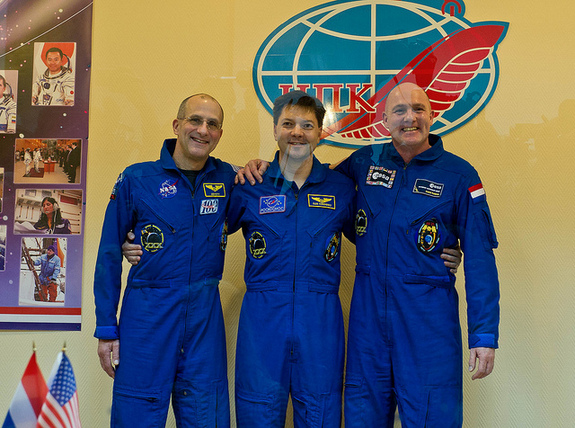 Expedition 30/31 crew members from left: NASA Flight Engineer Don Pettit, Soyuz Commander Oleg Kononenko and European Space Agency Flight Engineer Andre Kuipers are seen following a press conference held at the Cosmonaut Hotel on Dec. 20, 2011, in Baikonur, Kazakhstan.