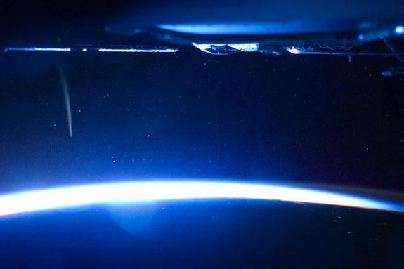 Comet Lovejoy is visible near Earth's horizon in this nighttime image photographed by NASA astronaut Dan Burbank, Expedition 30 commander, onboard the International Space Station on Dec. 21, 2011.