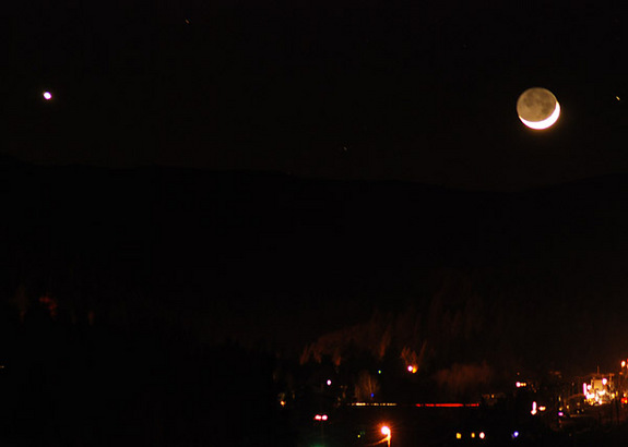 The bright moon and planet Venus shine over the city of Truckee, Calif., on Dec. 26, 2011 in this photo by skywatcher David Smoyer.