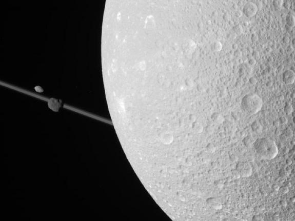NASA's Cassini spacecraft obtained this unprocessed image on Dec. 12, 2011. The camera was pointing toward Saturn's moon Dione from approximately 69,989 miles (112,636 kilometers) away.