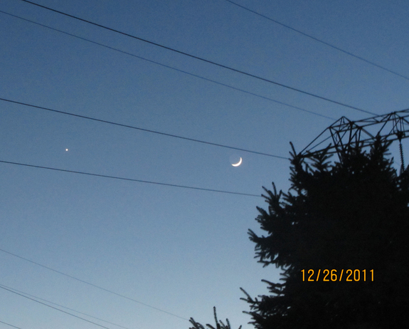 The crescent moon and Venus shine bright on Dec. 26, 2011 as daylight wanes in Chester County, Pa., in this photo snapped by skywatcher Pat Curry.