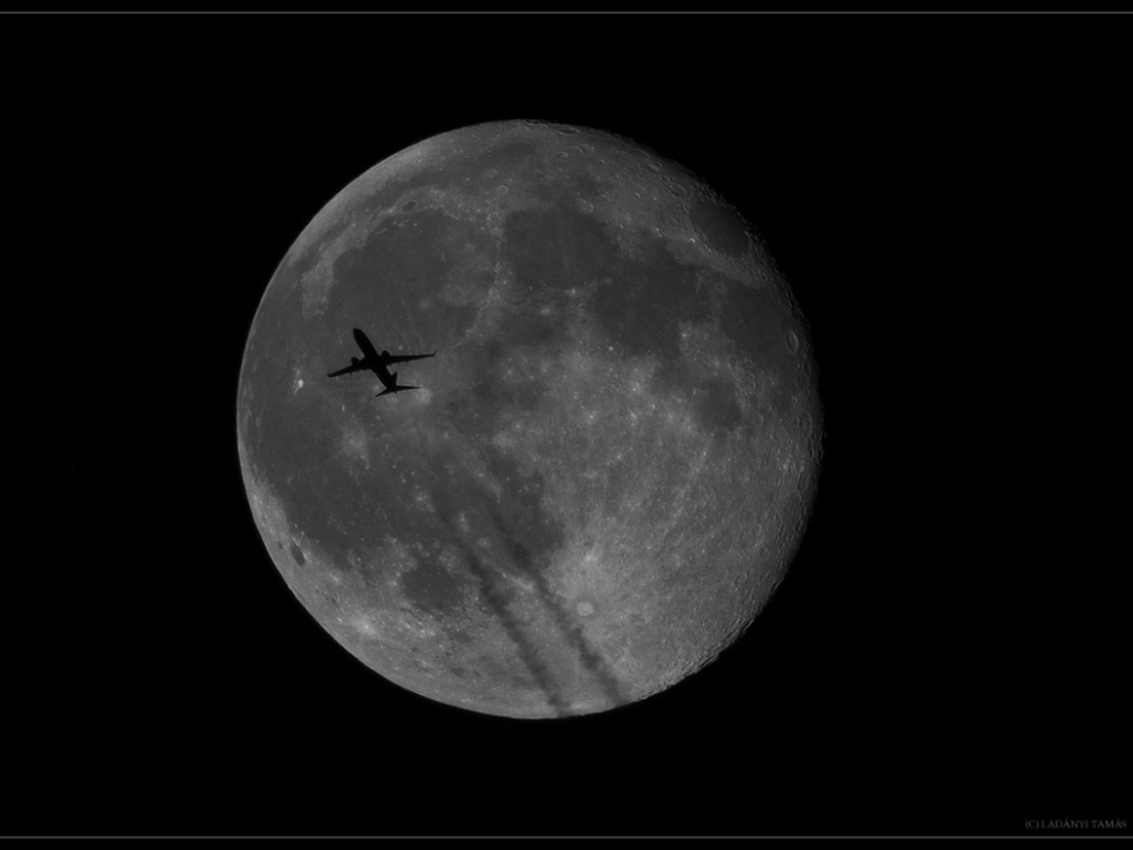 Plane Crosses Full Moon