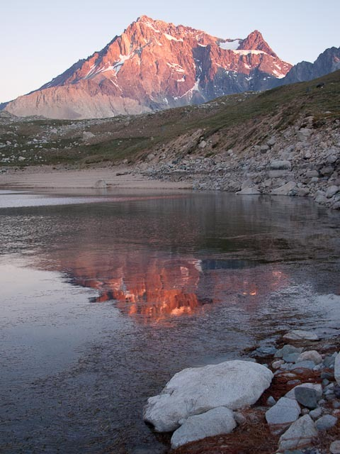 At sunset, the normally gray Meson Alto, the mountain that dominates the view to the east of Laguna Negra, glows with color.