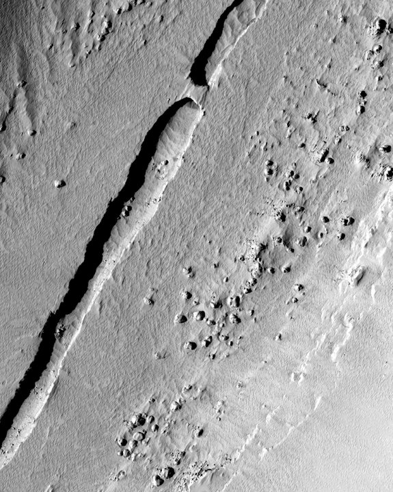 NASA's Mars Reconnaissance Orbiter snapped this shot of a trough running down the center of a valley in the Tartarus Colles region of Mars. Scientists think the structure originally formed as a lava tube.