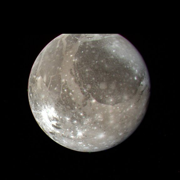 NASA's Voyager 2 spacecraft snapped this color image of Jupiter's moon Ganymede, the largest satellite in the solar system, on July 7, 1979 from a distance of 745,000 miles (1.2 million kilometers).