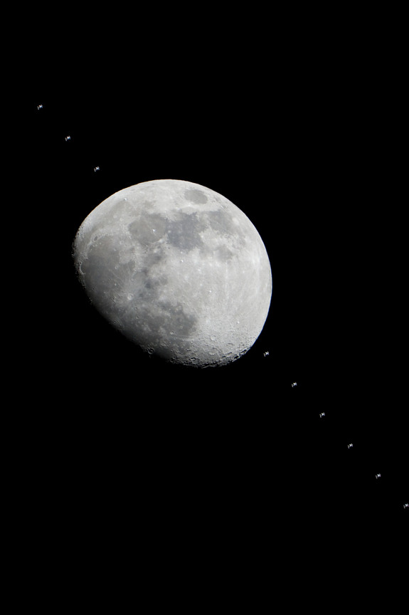 Multiple images of the International Space Station flying over the Houston area have been combined into one composite image to show the progress of the station as it crossed the face of the moon in the early evening of Jan. 4, 2012.