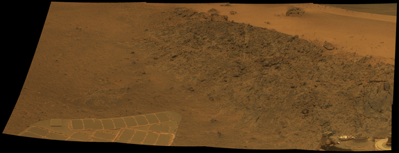 This mosaic of the rock outcrop Greeley Haven on Mars was acquired by the  rover Opportunity's Panoramic Camera (Pancam) on Sol 2,793 (Dec. 2, 2011)