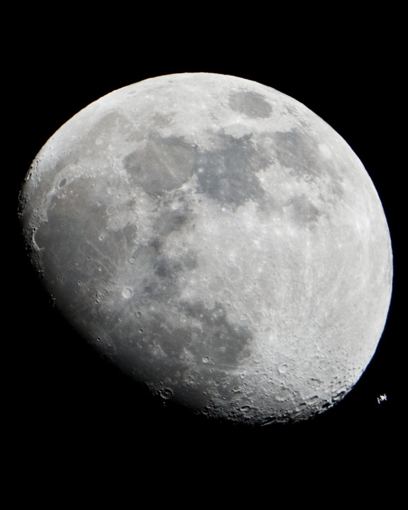 The International Space Station can be seen as a small object in lower right of this image of the moon in the early evening Jan. 4 in the skies over the Houston area flying at an altitude of 390.8 kilometers (242.8 miles).