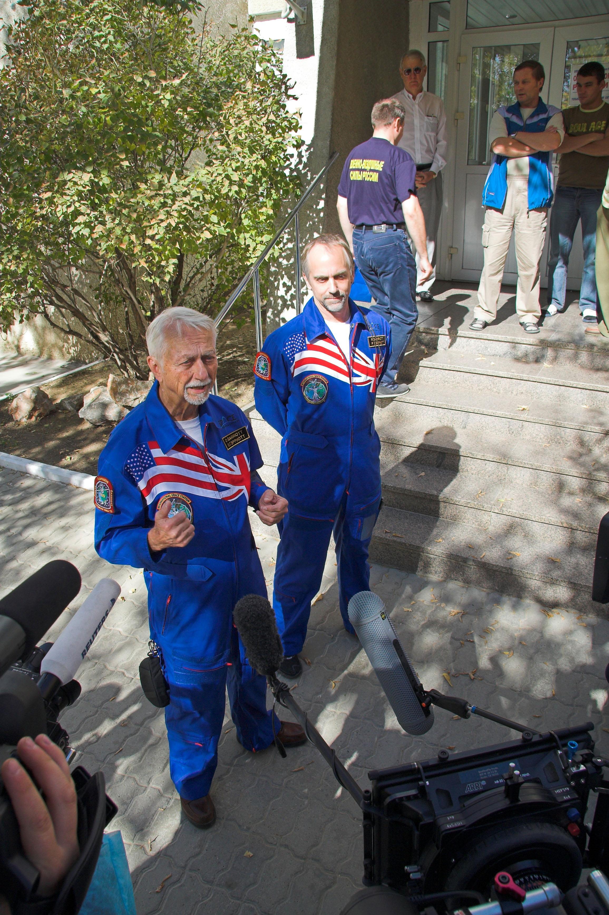 Astronaut Owen Garriott assists his son, Richard Garriott