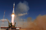 The Soyuz TMA-13 spacecraft launches from the Baikonur Cosmodrome in Kazakhstan on Oct. 12, 2008 carrying a new crew to the International Space Station (ISS).