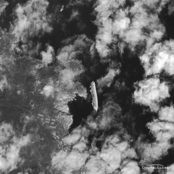 This photo, taken by a DigitalGlobe Earth-observing satellite, shows the cruise ship Costa Concordia as it appeared from space on Jan. 17, 2012. The luxury cruise ship ran aground in the Tuscan waters off of Giglio, Italy on Friday, January 13, 2012.