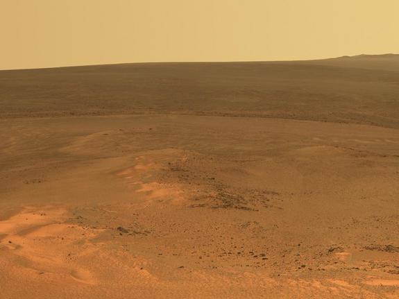 "NASA's Opportunity Mars rover took this mosaic of images with its panoramic camera in mid-January 2012. It shows the windswept vista northward (left) to northeastward (right) from the location where Opportunity is spending its fifth Martian winter, an outcrop informally named ""Greeley Haven."""