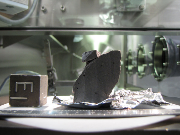 This image shows an Apollo moon rock sample (catalogued as 10020,234) in the Lunar Sample Laboratory at the Johnson Space Center, Houston.