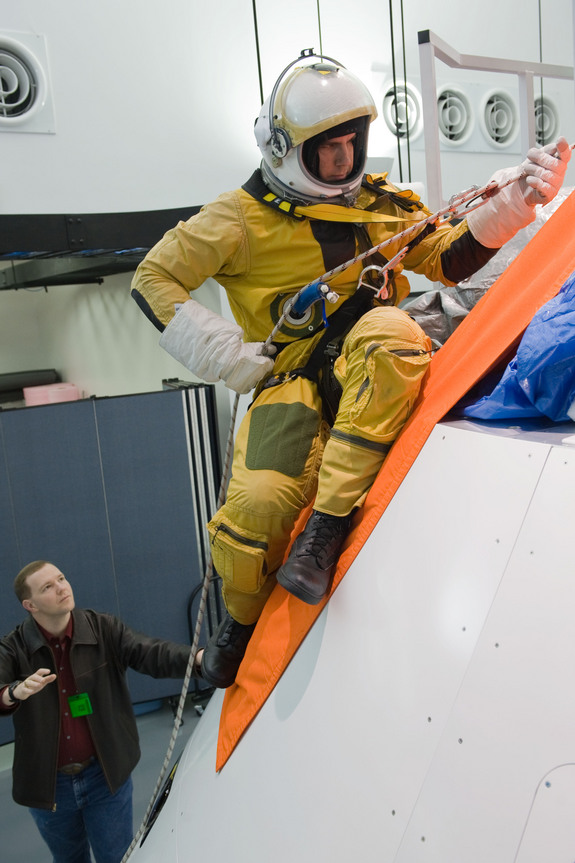 Lockheed Martin engineers test emergency escape procedures from NASA's new Orion capsule at the the Exploration Development Lab in Houston.