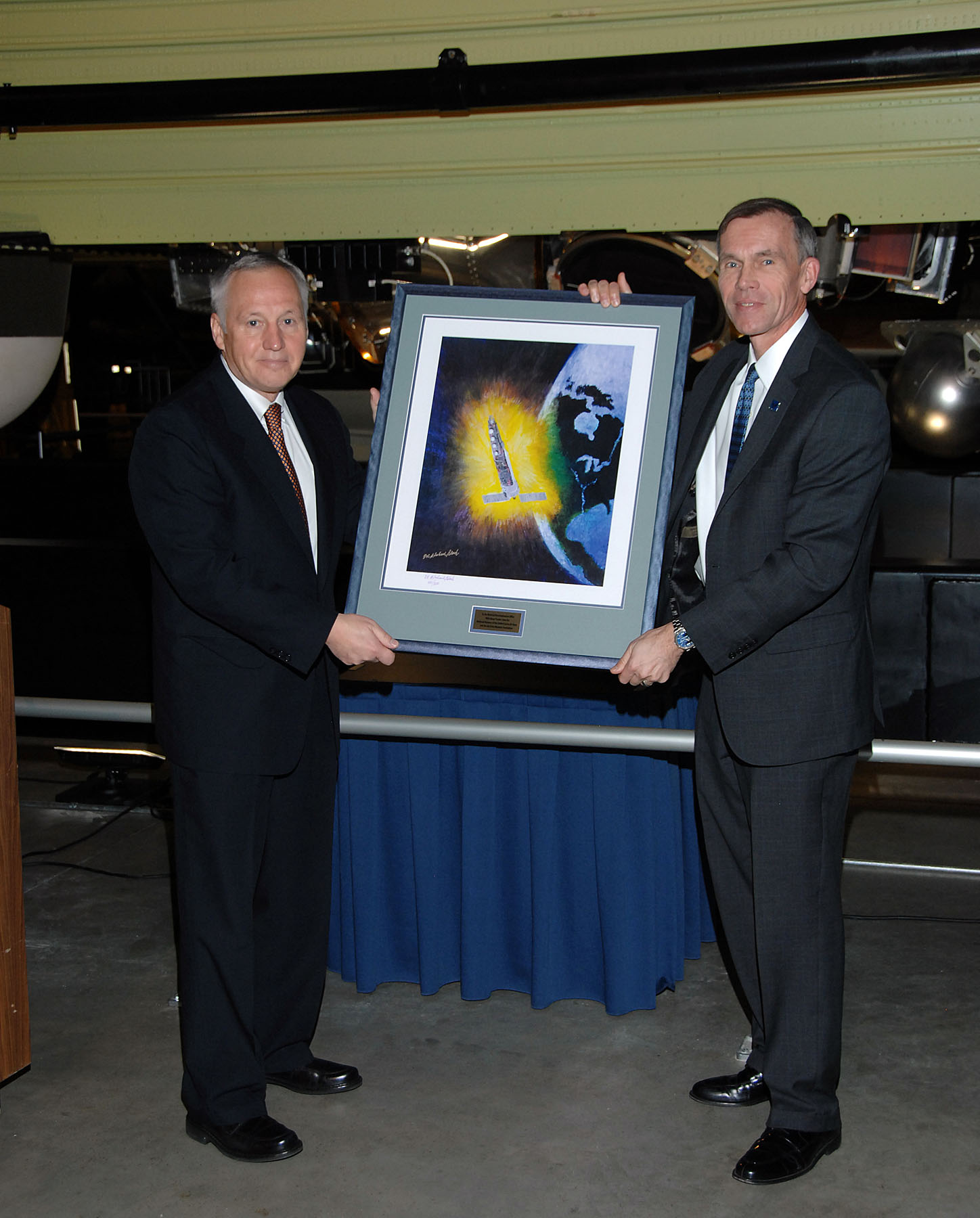 Presentation of a Painting of the Hexagon Satellite