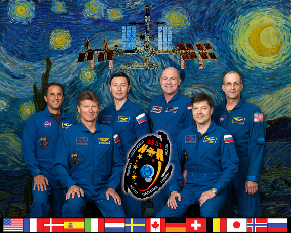 Expedition 31 crew members take a break from training at NASA's Johnson Space Center to pose for a crew portrait. Image released July 14, 2011.