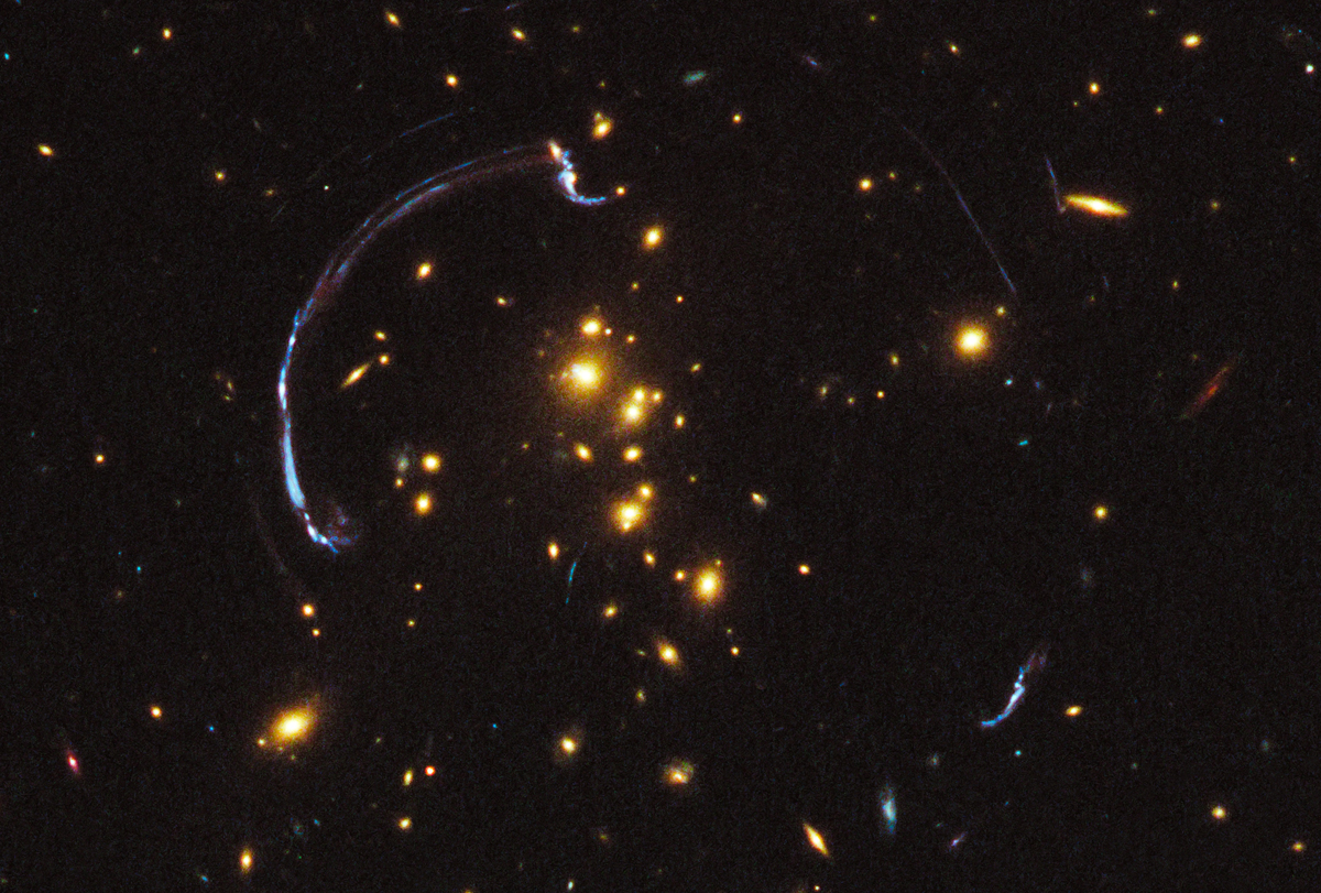 Brightest Galaxy Ever Seen With Gravity Lens Shines in Hubble Photo